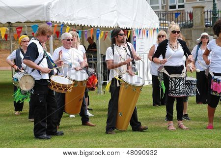 ST.LEONARDS-ON-SEA, ENGLAND - JULY 13: The Dende Nation samba drum troupe perform at the St.Leonards Festival on July 13, 2013 at St.Leonards-on-Sea, Sussex. The annual event was first held in 2006.