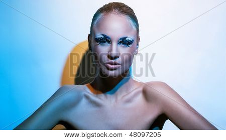 Beautiful young caucasian woman with artistic makeup
