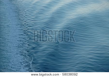 White Backwash Of A Ferry Crossing Blue Ocean