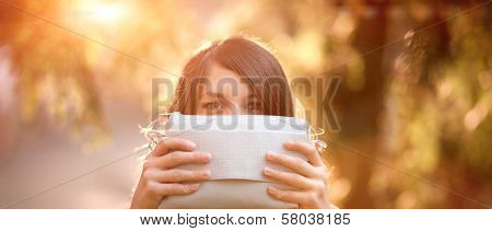 Girl Hidding By Holding A Purse