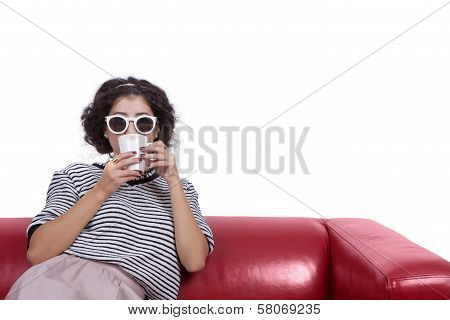 Young woman with sunglasses drinking coffee