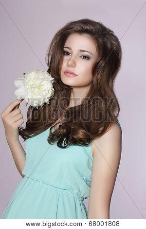 Sincere Gentle Meek Woman With Peony Flower