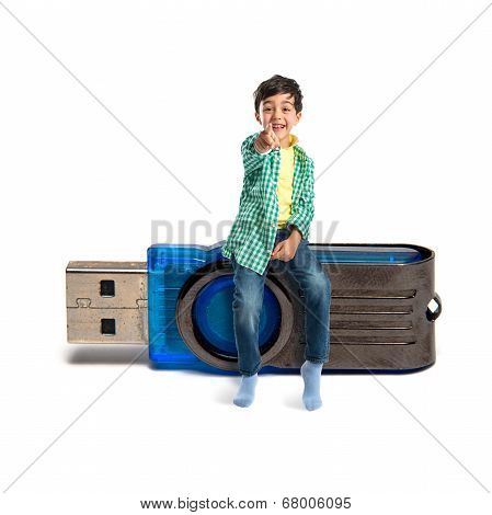 Kid Pointing To The Front On Pendrive