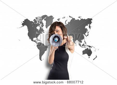 Pretty Girl Shouting With A Megaphone Over Map Background