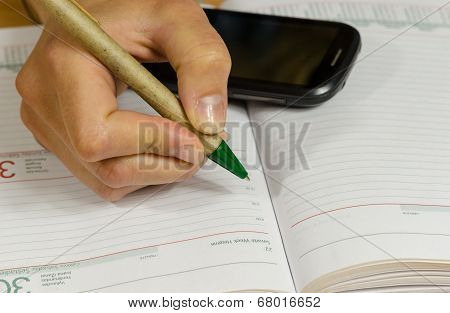 Hand Make Write Notes In Notebook And Smart Phone