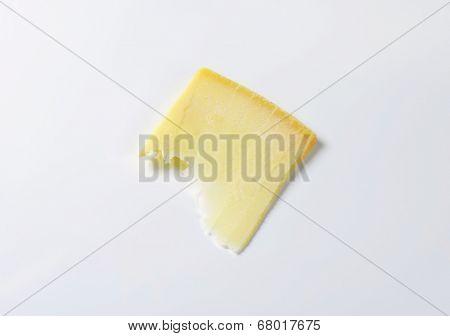 thin slice of hard cheese