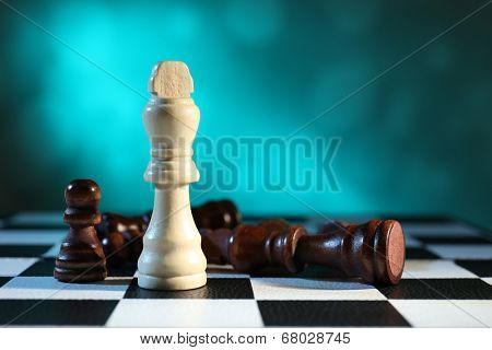 Chess board with chess pieces on light blue background
