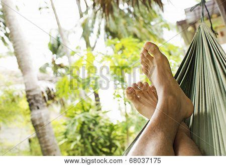 Feet resting inside a hammock