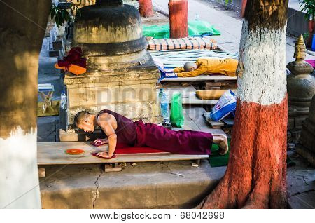 Bodhigaya, India - May 13, 2014: Tibetan Buddhist Monks Salute To Buddha Around Mahabodhigaya Temple