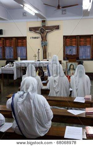KOLKATA, INDIA - FEBRUARY 07: Sisters of Mother Teresa's Missionaries of Charity in prayer in the chapel of the Mother House, Kolkata, India at February 07, 2014.