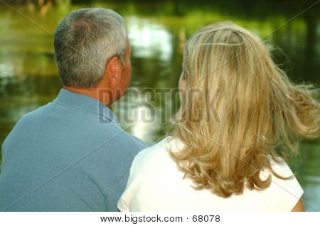 Couple Looking At Pond