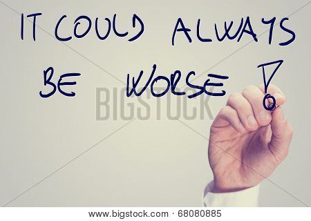 Male hand writing motivational message It could always be worse on virtual board vintage effect toned image. poster