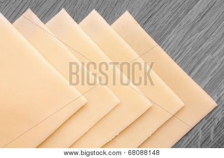Rolled slices of yellow cheese