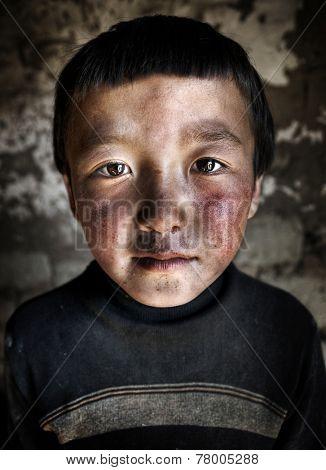 Portrait of a Mongolian Boy. Western Mongolia, Mongolia.