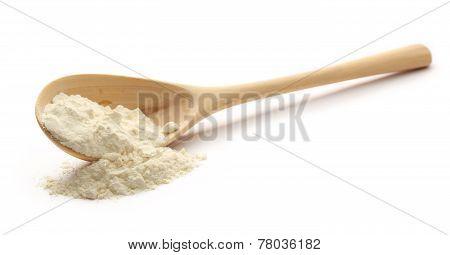 White Wheat Flour In Wooden Spoon
