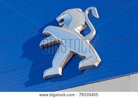 The Emblem Peugeot On The Building Of Official Dealer