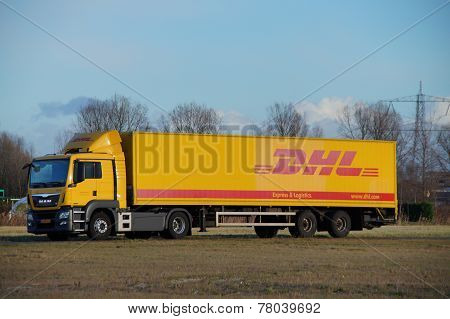 DHL delivery truck parked at dusk
