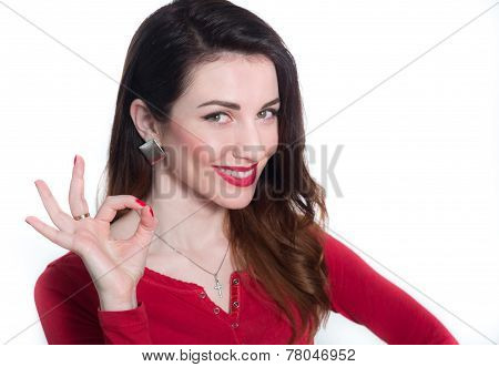 pretty woman showing ok sign with fingers