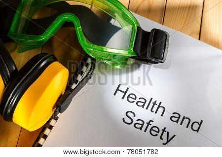 Register with goggles and earphones on wooden background poster