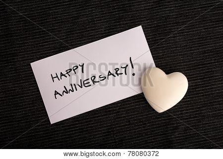 Happy Anniversary Handwritten On A White Card