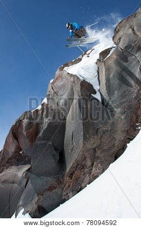 Skier is jump from high cliff.