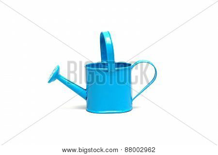 a blue watering can on isolated background