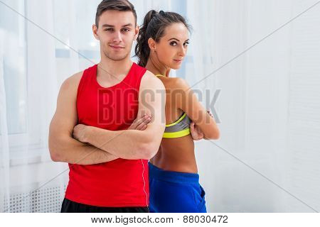 sporty couple friends slim athletic ambitious woman and confident man trainers team or coach client