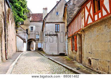 Cobblestone lane in a Burgundy village, France