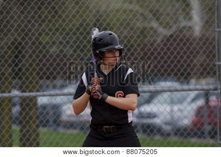 A Female Fastpitch Softball Player Sizing Up The Pitcher