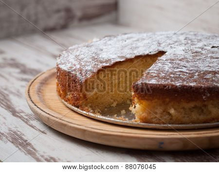 Sponge Cake Of Lemon Over Wooden Background