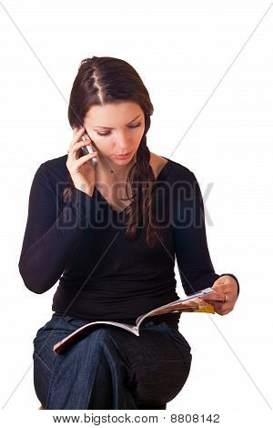 Caucasian Girl Reading Magazine And Talking By Mobile Phone.