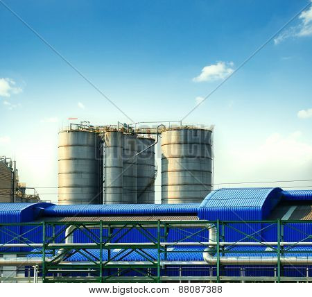 Industry Tank Strage In Heavy Industrial Estate Plant Against Beautiful Blue Sky