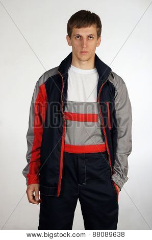 Man posing in overalls.isolated studio portrait.Grey background poster