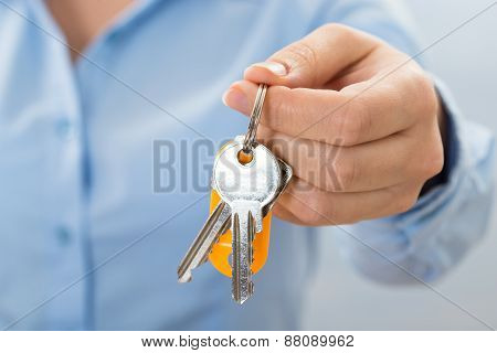 Businessperson Hand Holding Key
