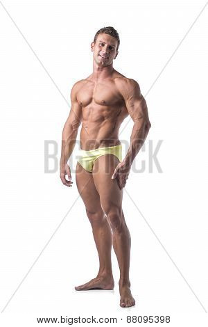Full body shot of shirtless muscular young man standing