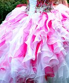 Quinceanera gown worn by a young teenager at her coming out ceremony. poster