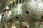 Rows of ornate incense burner in market, Nizwa, Oman poster