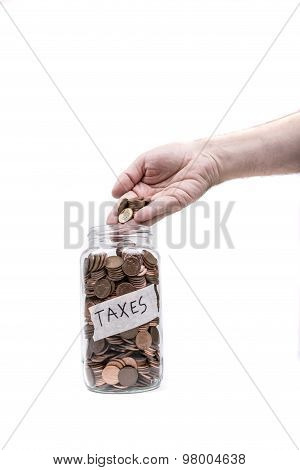 Jar labeled Taxes being fileld with British pennys