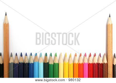 Two Simple Wooden Pencils Among Colour Pencils