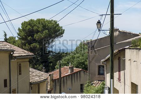 View Over Typical Houses To The Mountains In Provence, South Of France