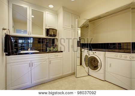 Laundry Room With Washer Dryer, And Miror Folding Doors.