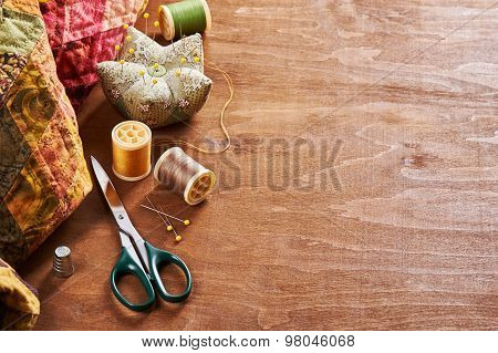 Accessories For Patchwork On A Quilt On A Wood Background
