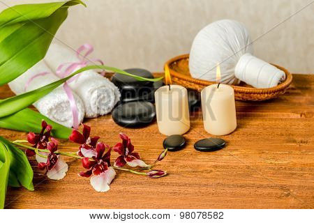 Spa Still Life Of Orchid Flower, Cambria, Thai Herbal Compress Balls In Basket, Towels, Zen Stones A
