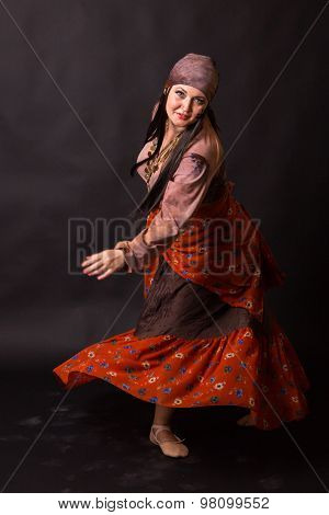 Woman actress dancing. Professional stage make-up.