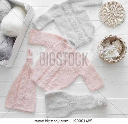 Lovely pink and gray pastel clothes for infant, handmade, hat and sweater, body, topview