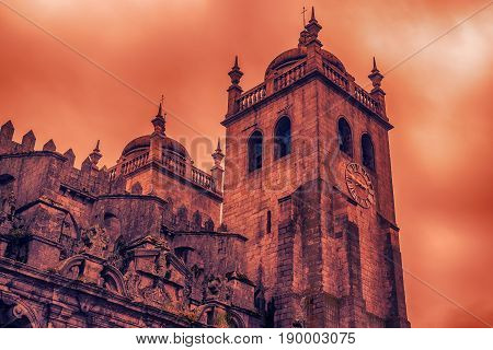 Porto, Portugal: the tower of Cathedral of the Assumption of Our Lady at sunset