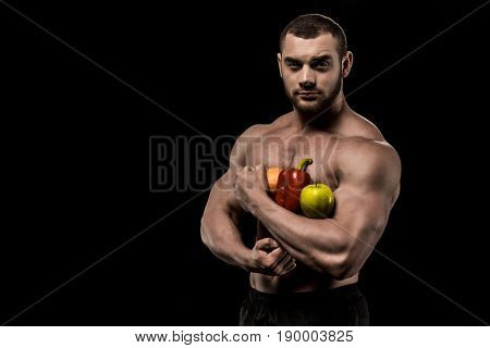 Portrait Of Shirtless Man Holding Healthy Food Isolated On Black