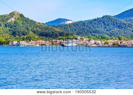 Thassos, Greece - May 1, 2016: Thassos port and town view with ferry boat