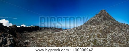 Panorama inside crater of Pico volcano and Piquinho pinnacle at Azores Portugal
