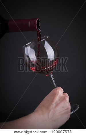 Red wine. Glass of wine. Pouring red wine